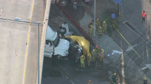 A big rig crashed into several vehicles in the Pacoima area on April 17, 2015. (Credit: KTLA)