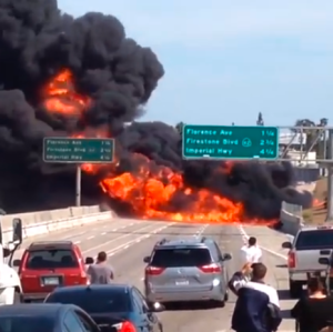 Motorists stranded on the 710 Freeway looked on as a tanker truck carrying gasoline burned in Bell on Sunday, April 26, 2015. (Credit: Ludwing Perez)