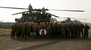 U.S. Marines and sailors with Marine Light Attack Helicopter Squadron 469 attached to Joint task Force 505 stand in front of their UH-1Y Hueys at the Tribhuvan International Airport in Kathmandu, Nepal, May 9, 2015. (Credit: U.S. Marine Corps / Lance Cpl. Mandaline Hatch)