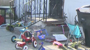 Children's toys could be seen outside a home where a 3-year-old boy was stabbed on May 19, 2015. (Credit: KTLA)