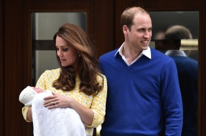 Britain's Prince William, Duke of Cambridge, and his wife Catherine, Duchess of Cambridge show their newly-born daughter, their second child, to the media outside the Lindo Wing at St Mary's Hospital in central London, on Saturday, May 2, 2015. (Credit: Leon Neal/AFP/Getty Images)