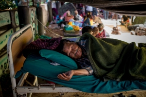 Patients at Manmohan Memorial Hospital health camp are moved out of the hospital building and housed in makeshift shelters following a second major earthquake May 13, 2015 in Kathmandu, Nepal. (Credit: Jonas Gratzer/Getty Images)