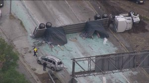 All lanes were blocked on the transition road from the southbound 5 Freeway to the eastbound 60 Freeway in Boyle Heights after a big-rig crash on Monday, May 18, 2015. (Credit: KTLA)