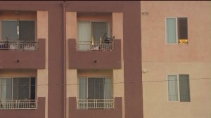 An anonymous telephone tip led police to the body of a 48-year-old woman inside the closet of an apartment in Panorama City. (Credit: KTLA)