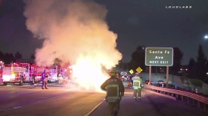 A fiery crash closed multiple lanes on the 405 Freeway in Caron on May 5, 2015. (Credit: Loudlabs)