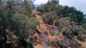 Firefighters battle a brush fire in the Glendora foothills on Wednesday, May 13, 2015. (Credit: Glendora Police Department)
