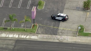 Crime scene tape and barricades are seen in a driveway at a shopping center in Gardena on Thursday, May 7, 2015. (Credit: KTLA)