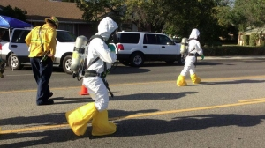 At a Simi Valley home on May 11, 2015, Firefighters prepared to take samples of a hazardous material suspected of being mercury. (Credit: Ventura County Fire Department)