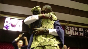U.S. Navy Petty Officer 2nd Class Vera Turner embraces her son, Steven Turner Jr., at his high school graduation on ceremony. (Credit: WBMA via CNN)
