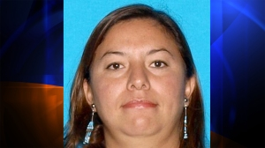 Leticia Smith, 33, of Victorville wanted for the murder of her husband Antoine Smith. (Credit: DMV)