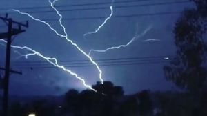 A still image from an Instagram video by @this_means shows lightning in the Hollywood area on Thursday, May 14, 2015.