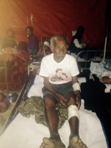 Funchu Tamang, 101, sits on a bed in a hospital in Nuwakot district on May 3, 2015 around 80 kilometres (50 miles) northwest of Kathmandu where he was taken after being rescued from his collapsed home a day earlier. (Credit: STR/AFP/Getty Images)