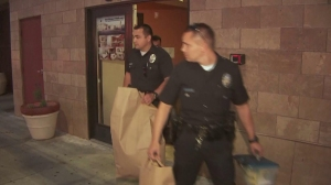 Police remove evidence from a North Hills apartment building where the body of a 48-year-old woman was found inside a closet on May 4, 2015. (Credit: KTLA)