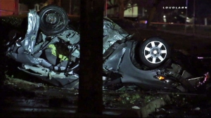 A overturned car involved in a fatal collision in Pomona is seen in this image. (Credit: Loudlabs)
