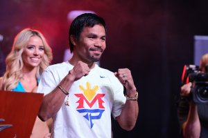 Manny Pacquaio arrives to the cheers of hundreds of fans upon his arrival at Mandalay Bay Resort and Casino on Tuesday, April 28, 2015, in preparation for his May 2 bout with Floyd Mayweather. (Credit: Las Vegas News Bureau)