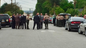 Investigators at the scene of a fatal shooting involving a deputy in South El Monte on Tuesday, May 5, 2015. (Credit: KTLA)