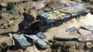"Graffiti is seen on some of the rocks at ""Sunken City"" in San Pedro. (Credit: KTLA)"