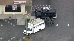 SWAT officers are seen outside a dd's Discounts store in Gardena on Thursday, May 7, 2015. (Credit: KTLA)