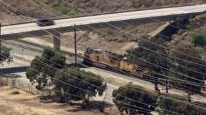 """A train was stopped in Sylmar after the conductor reported finding an """"IED,"""" according to LAPD, on May 20, 2015. (Credit: KTLA)"""