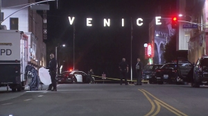 An investigation was underway on May 6, 2015, into an officer-involved shooting that left a homeless man injured, police said. (Credit: KTLA)