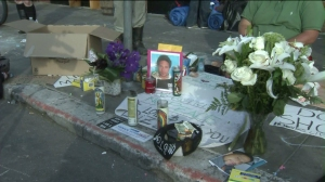 A make-shift memorial was set up Wednesday at the site where an unarmed  29-year-old homeless man was shot and killed by police on May, 5, 2015. (Credit: KTLA)
