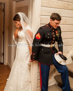 A moving photograph of a U.S. Marine praying with his bride before their wedding has gone viral. (Credit: Dwayne Schmidt Photography)