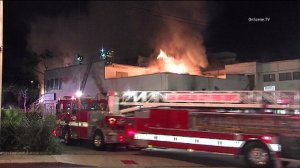 A three-alarm blaze broke out at a homeless encampment in West Hollywood on May 20, 2015. (Credit: OnScene)