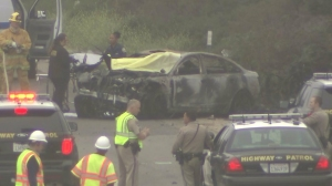 An investigation was underway into a multi-car crash that left one person dead on June 14, 2015. (Credit: KTLA)