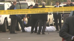 The L.A. County coroner's office arrived at the scene of a fatal shooting on June 17, 2015, to remove the body of a bicyclist who had been killed. (Credit: KTLA)