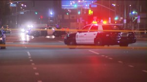 Police responded after two related shootings in the Florence-Firestone neighborhood of South Los Angeles on Sunday, June 14, 2015. (Credit: KTLA)