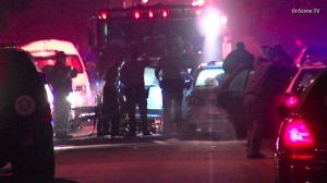 A homicide investigation was underway after a man was fatally shot inside his car at an intersection in East Compton on Dec. 23, 2014. (Credit: OnScene TV)