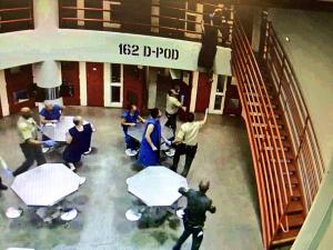 Surveillance video shows an inmate attempting to jump from a walkway at the Twin Towers jail on Monday, June 22, 2015. (Credit: Los Angeles County Sheriff's Department)
