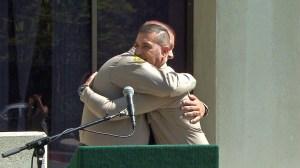 Jorge Castro (Left) and Javier Tiscareno hug during a news conference on Tuesday, June 2, 2015. (Credit: KTLA)