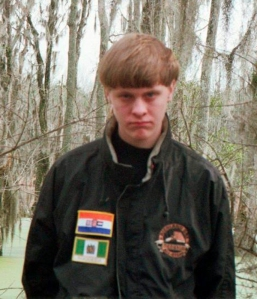 In an image tweeted by authorities in Berkeley County, South Carolina, Dylann Roof seen is wearing a jacket with what appear to be the flags of apartheid-era South Africa and nearby Rhodesia, a former British colony that a white minority ruled until it became independent in 1980 and changed its name to Zimbabwe.