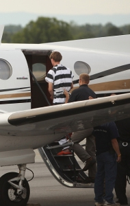 Dylann Roof of Lexington, South Carolina, boards a plane at Shelby-Cleveland County Regional Airport for extradition back to Charleston, South Carolina on June 18, 2015 in Shelby, North Carolina. (Credit: Andy McMillan/Getty Images)
