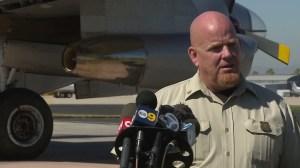 Mike Eaton, forest aviation officer for the San Bernardino National Forest, speaks at the service's air tanker base in San Bernardino on June 25, 2015. (Credit: KTLA)