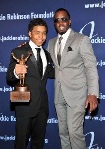 """Justin Combs, left, and his father Sean """"Diddy"""" Combs attend the 2011 Jackie Robinson Foundation Awards Gala on March 7, 2011, in New York City.  (Credit: Stephen Lovekin/Getty Images for The Jackie Robinson Foundation)"""