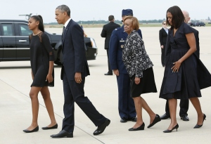 President Barack Obama with first lady Michelle Obama, daughter Sasha and mother-in-law Marian Robinson arrive in Delaware on Saturday, June 6, 2015. (Credit: Yuri Gripas/AFP/Getty Images)