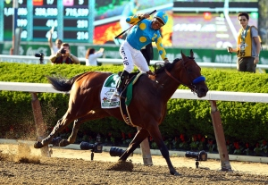 Victor Espinoza, celebrates atop American Pharoah #5, after winning the 147th running of the Belmont Stakes at Belmont Park on June 6, 2015, in Elmont, New York. With the wins American Pharoah becomes the first horse to win the Triple Crown in 37 years.  (Credit: Al Bello/Getty Images)