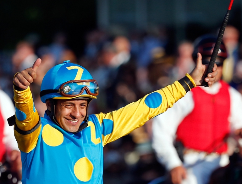 Victor Espinoza, celebrates atop American Pharoah #5, after winning the 147th running of the Belmont Stakes at Belmont Park on June 6, 2015, in Elmont, New York. (Credit: Rob Carr/Getty Images)