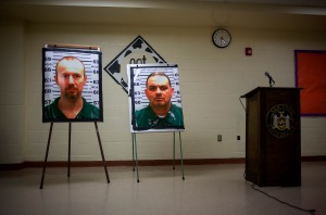 Pictures of escaped prisoners Richard Matt and David Sweat are displayed at a press conference in Saranac, New York, on Friday, June 12, 2015. (Credit: Eric Thayer/Getty Images)
