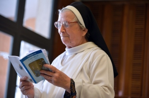 """A nun reads Pope Francis's encyclical, a collection of principles to guide Catholic teaching, entitled """"Laudato Si,"""" during its official presentation, on June 18, 2015, at the Sinod hall at the Vatican. Pope Francis calls on the world's leaders to pull together to fight global warming, publishing his hotly anticipated thesis on the environment, which slams profiteers and slaves to progress. (Credit: VINCENZO PINTO/AFP/Getty Images)"""