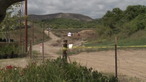 Police were investigating a man's body found at a graded construction area in Irvine on June 5, 2015. (Credit: KTLA)