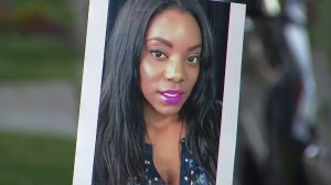 Lajoya McCoy is seen in a photo at a vigil that was held for the 31-year-old mother of two on June 16, 2015. (Credit: KTLA)