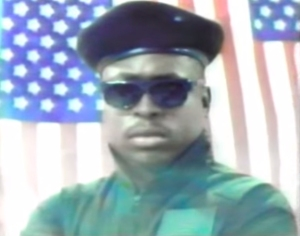 "Dwayne Coleman, also known as 1990s rapper MC Supreme, is seen in a screenshot from his music video for the single ""Black in America."" He died in a crash on PCH in Malibu on Saturday."