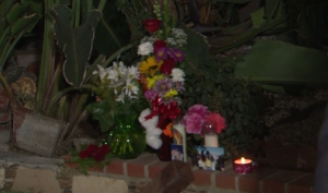 Flowers, candles and photos were placed at the site of a fatal crash in Northridge on June 21, 2015. (Credit: KTLA)