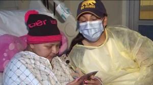 Cecilia Saravia, 20, and her mother Estella Laskano keep each others spirits up. (Credit: KTLA)