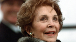 Former US First Lady Nancy Reagan looks on at the christening ceremony of the aircraft carrier USS Ronald Reagan on March 4, 2001 at Newport News Shipbuilding Yard in Virginia. (Credit: Mario Tama/AFP/Getty Images)