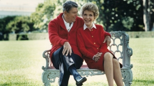 Former U.S. President Ronald Reagan and First Lady Nancy Reagan share a moment in this undated file photo. (Credit: Ronald Reagan Presidential Library/Getty Images)