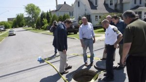 New York Gov. Andrew Cuomo looks at the manhole two convicted murderers allegedly climbed through to escape a maximum security prison. Guards realized they were missing on June 6, 2015.